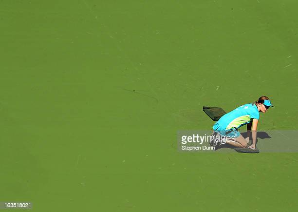 A ball kid tends her position on Stadium Court One during day 6 of the BNP Paribas Open at Indian Wells Tennis Garden on March 11 2013 in Indian...