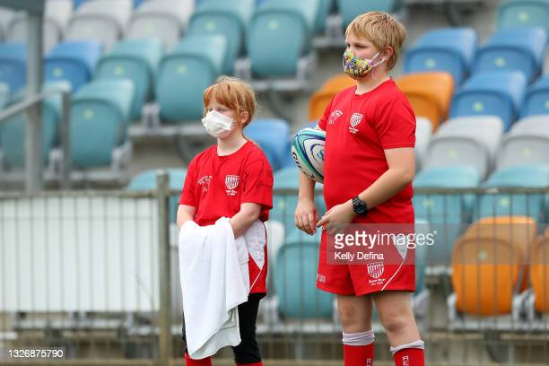Ball kids are seen during the Super W match between the Melbourne Rebels and the ACT Brumbies at Coffs Harbour International Stadium on July 03, 2021...