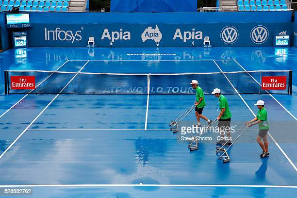 Ball kids clean up after rain delays play on the Show Court at the Apia International Sydney at Sydney Olympic Park Tennis Centre Sydney Australia...