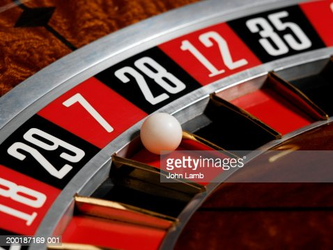Ball Landing In Red Number 7 On Roulette Wheel Closeup
