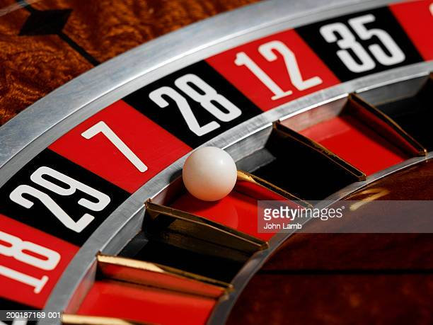 Ball landing in red, number 7, on roulette wheel, close-up