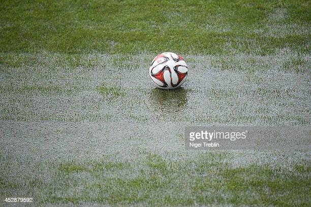 Ball lies on the pitch after heavy rain during a training session at Hannover 96 training camp on July 28 2014 in Mureck Austria