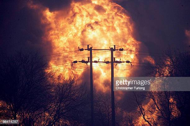 A ball of fire erupts as secondary explosions occur at Bruncefield oil depot on December 11 2005 in Hemel Hempstead EnglandThe explosions are being...
