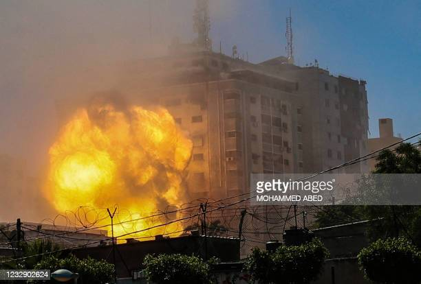Ball of fire erupts from the Jala Tower as it is destroyed in an Israeli airstrike in Gaza City, controlled by the Palestinian Hamas movement, on May...