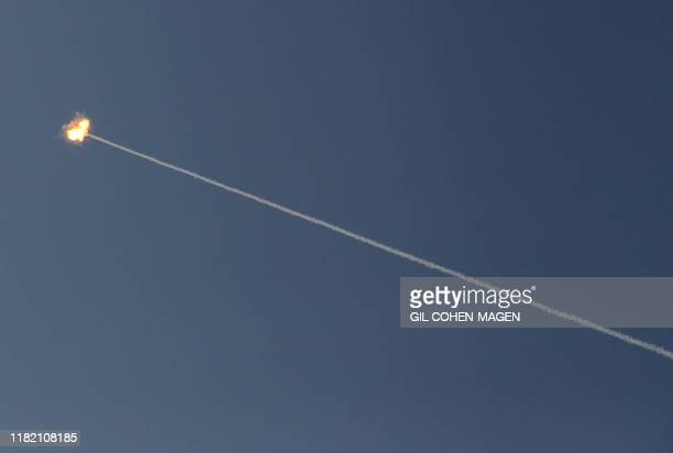 Ball of fire from an Israeli interception missile from the Iron Dome defence system, is seen in the sky above the southern Israeli city of Ashkelon...