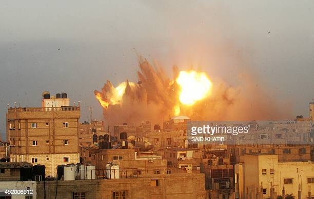 A ball of fire is seen following an early morning Israeli air strike on July 11 on Rafah in the southern of Gaza strip Israeli warplanes kept up...