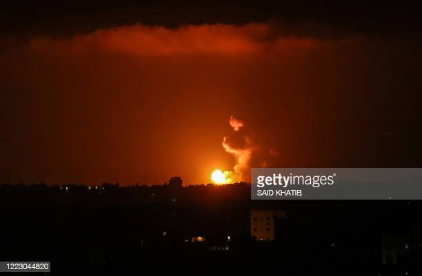 TOPSHOT A ball of fire is seen following an Israel airstrike at Khan Yunis in the southern Gaza Strip early on June 27 2020 Two rockets were fired...