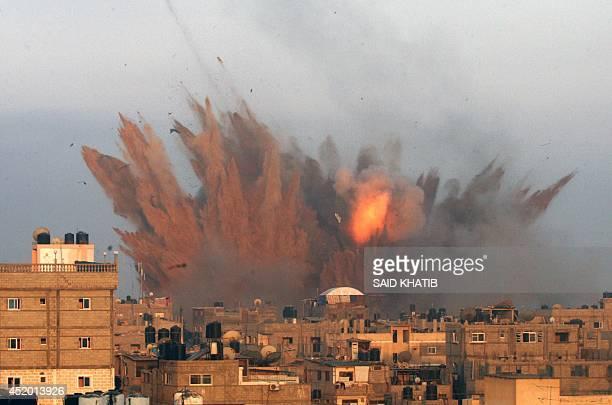 Ball of fire is seen following an Israeli air strike, on July 11, 2014 in Rafah, in the southern of Gaza Strip. Israeli warplanes kept up deadly...
