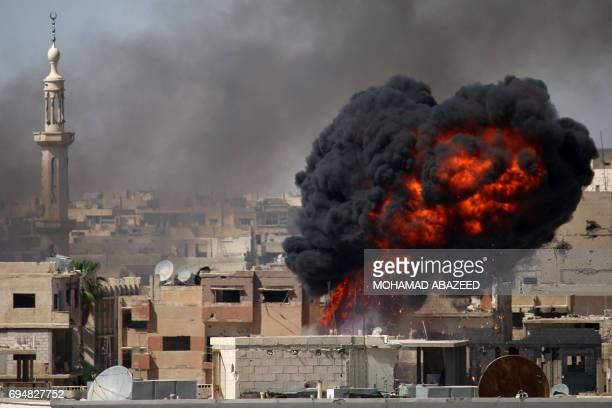 TOPSHOT A ball of fire rises from a building following a reported air strike by Syrian government forces on a rebelheld area in the southern city of...