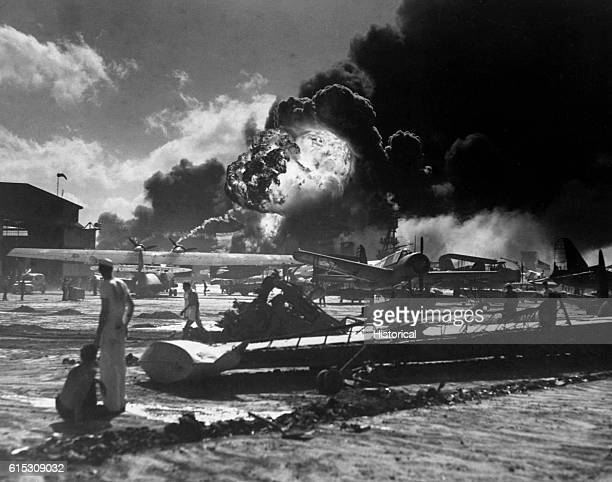 A ball of flame erupts from gasoline stores or aircraft at the Naval Air Station at Pearl Harbor Hawaii on December 7 1941 Base personnel can only...