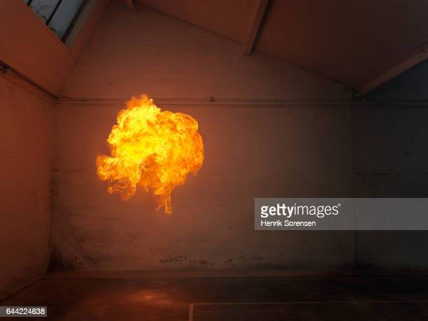 A ball of flames in an abandoned warehouse