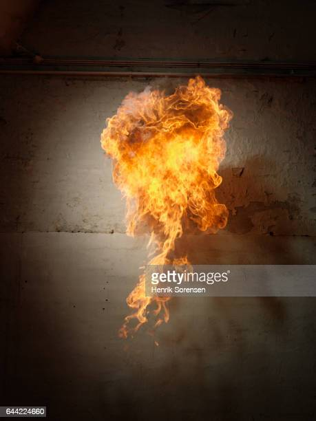 Ball of flames moving closely along a wall