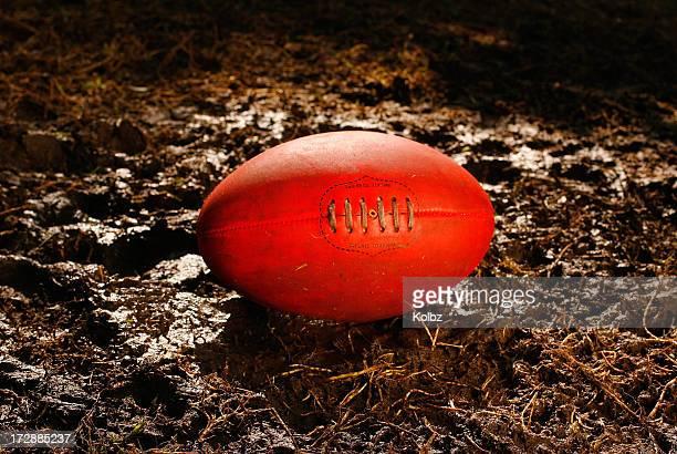 AFL Ball on a Muddy Field