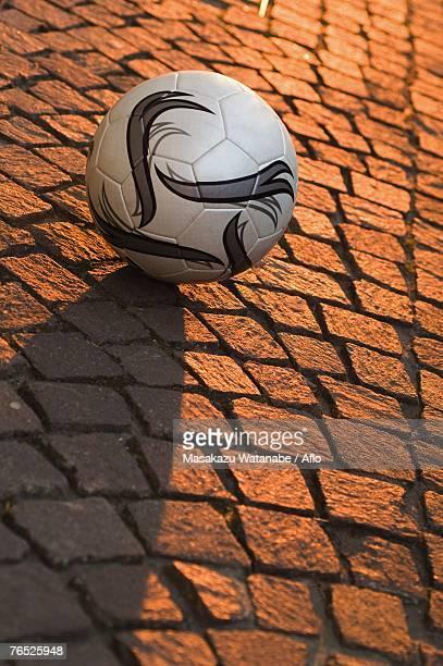 Ball on cobbled stone street