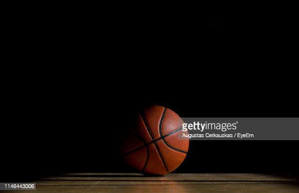 ball on table against black background - basketball ball stock pictures, royalty-free photos & images