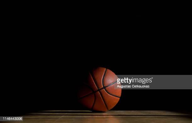 ball on table against black background - バスケットボール ストックフォトと画像