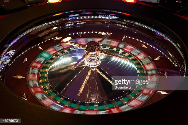 A ball rolls around a spinning roulette wheel inside the Canoe Bingo center operated by Codere SA in Madrid Spain on Monday Dec 30 2013 Codere SA...