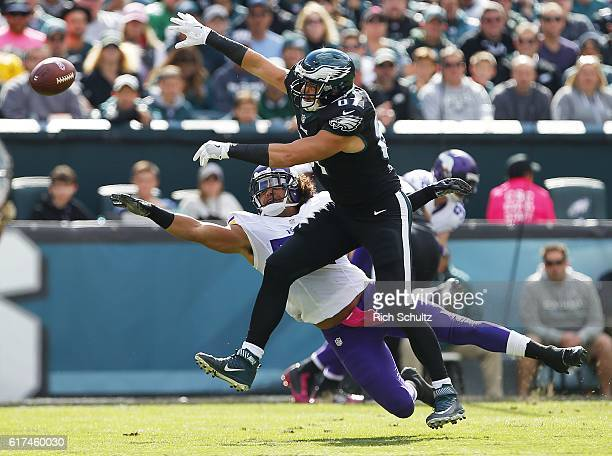 Ball sails past Brent Celek, front, of the Philadelphia Eagles and Eric Kendricks, back, en route to an interception in the first quarter during a...