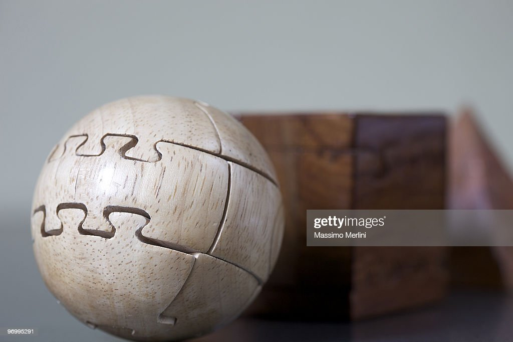 Ball Shaped Jigsaw Puzzle Made Out Of Wood Stock Photo