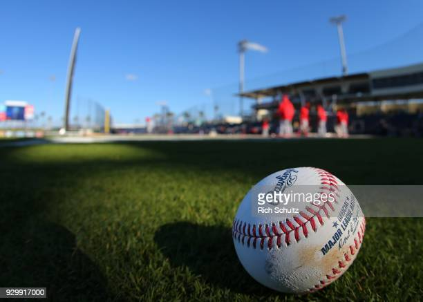 A ball sits on the field as the St Louis Cardinals take batting practice before a spring training game against the Houston Astros at FITTEAM Ball...