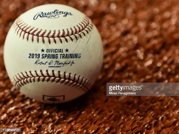 A ball sits on the field between the Toronto Blue Jays and the Milwaukee Brewers during MLB spring training at Olympic Stadium on March 25 2019 in...