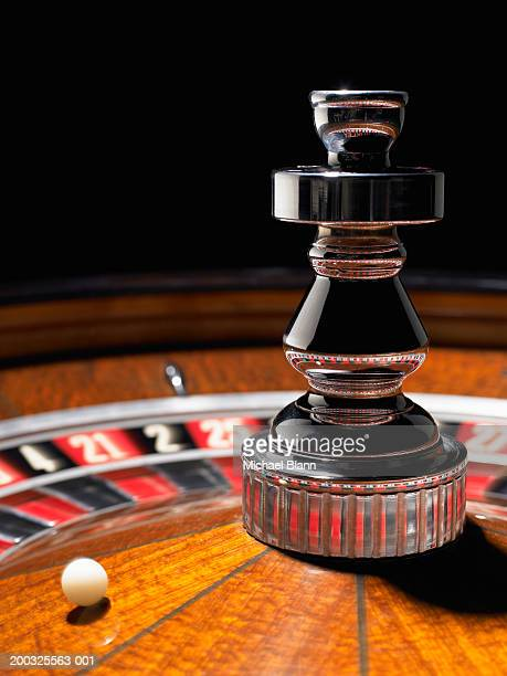 Ball spinning on roulette wheel