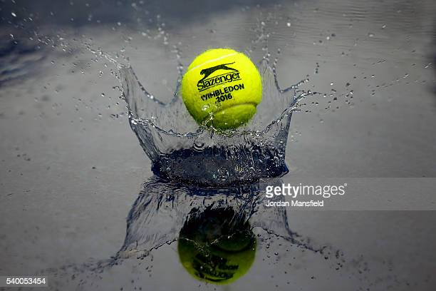 Ball splashes in the standing water as rain delays the start of play during day two of the Aegon Championships at the Queens Club on June 14, 2016 in...