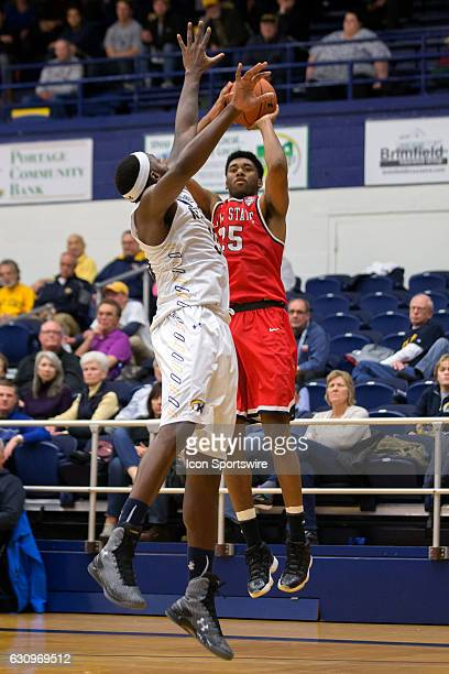 Ball State Cardinals F Tahjai Teague shoots as Kent State Golden Flashes F Jimmy Hall defends during the second half of the NCAA Men's Basketball...