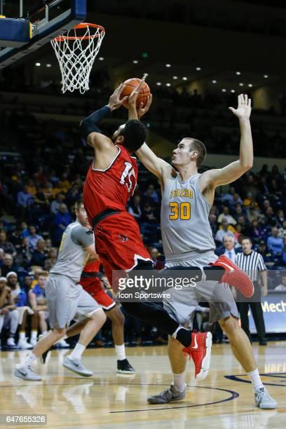 Ball State Cardinals forward Franko House goes in for a layup against Toledo Rockets forward Luke Knapke during a regular season basketball game...