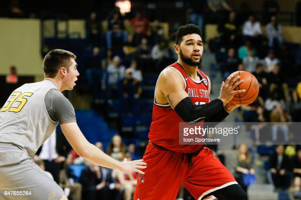 Ball State Cardinals forward Franko House looks to pass the ball during a regular season basketball game between the Ball State Cardinals and the...
