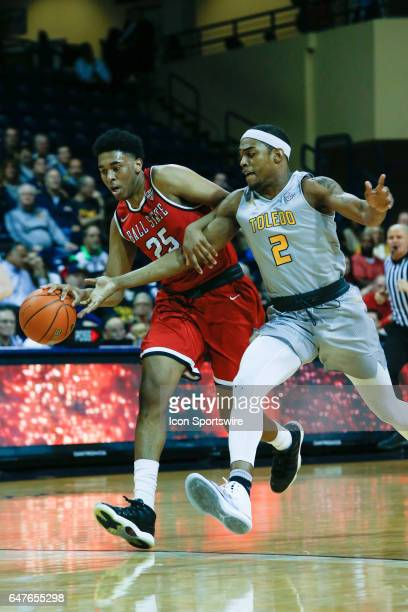 Ball State Cardinals forward Tahjai Teague brings the ball upcourt while being defended by Toledo Rockets forward Taylor Adway during a regular...