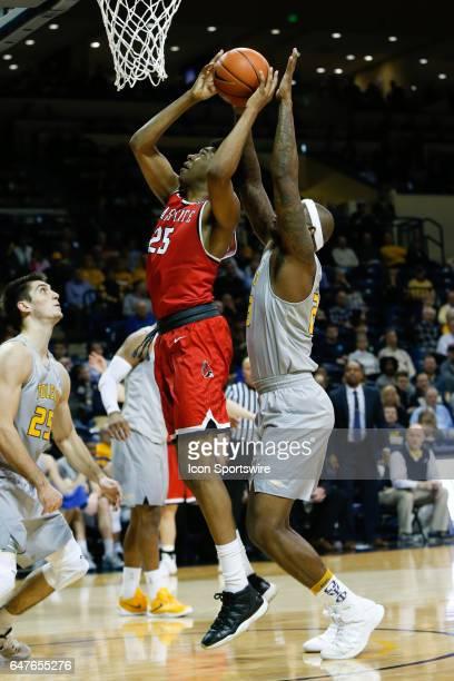 Ball State Cardinals forward Tahjai Teague puts up a shot against Toledo Rockets forward Steve Taylor Jr during a regular season basketball game...