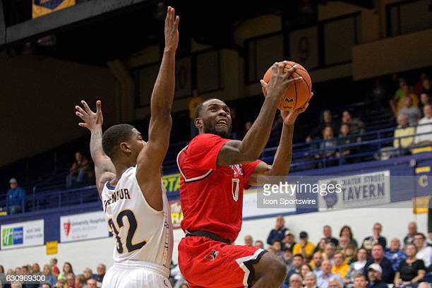 Ball State Cardinals G Francis Kiapway drive to the basket past Kent State Golden Flashes G Desmond Ridenour during the second half of the NCAA Men's...
