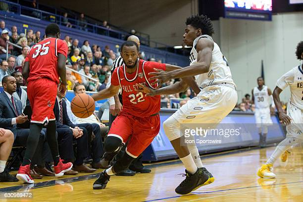 Ball State Cardinals G Jeremie Tyler is defended by Kent State Golden Flashes F Alonzo Walker during the second half of the NCAA Men's Basketball...