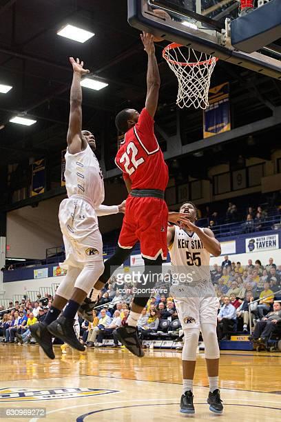 Ball State Cardinals G Jeremie Tyler shoots a layup as Kent State Golden Flashes G Deon Edwin and Kent State Golden Flashes G Kevin Zabo defend...