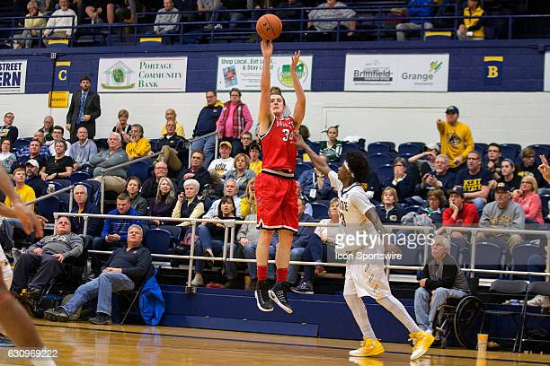 Ball State Cardinals G Sean Sellers shoots as Kent State Golden Flashes G Jaylin Walker defends during the second half of the NCAA Men's Basketball...