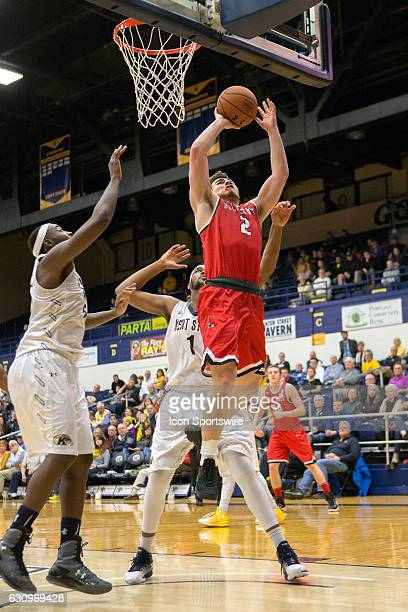 Ball State Cardinals G Tayler Persons goes up for a shot between Kent State Golden Flashes F Jimmy Hall and Kent State Golden Flashes C Adonis De La...