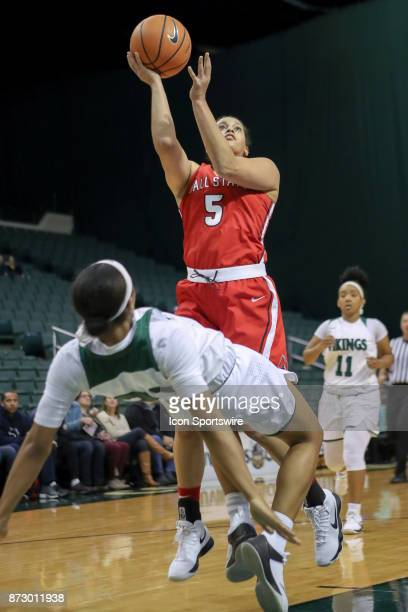 Ball State Cardinals guard Maliah HowardBass shoots after Cleveland State Vikings guard Jade Ely is called for a blocking foul during the second...