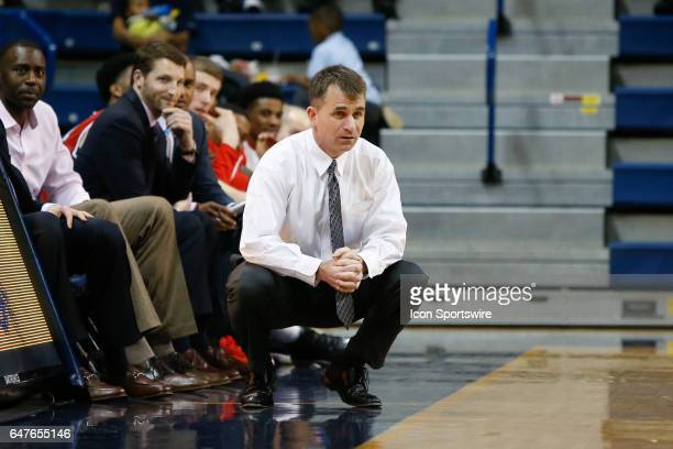 Ball State Cardinals head coach James Whitford watches the action on the court during a regular season basketball game between the Ball State...