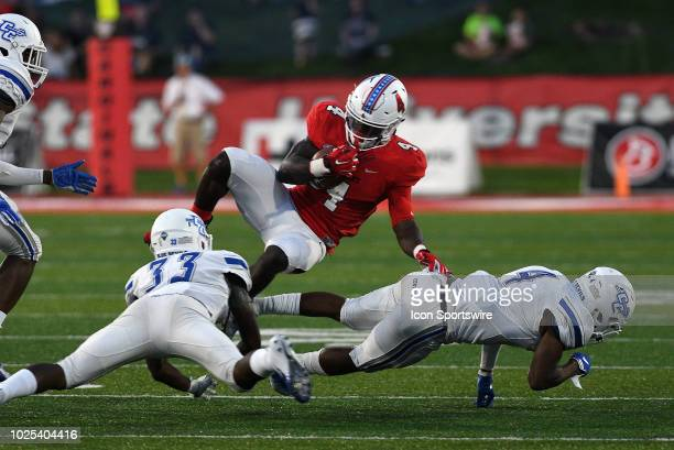 Ball State Cardinals running back Malik Dunner collides with Central Connecticut State University Blue Devils defensive back Kendall Coles and...