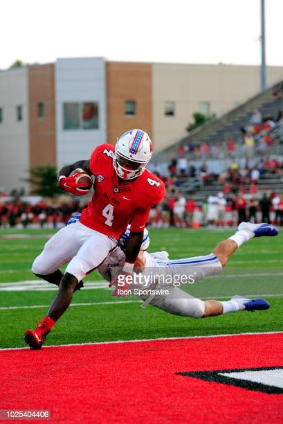 Ball State Cardinals running back Malik Dunner stiff arms Central Connecticut State University Blue Devils safety Kyle Baum on his way into the end...