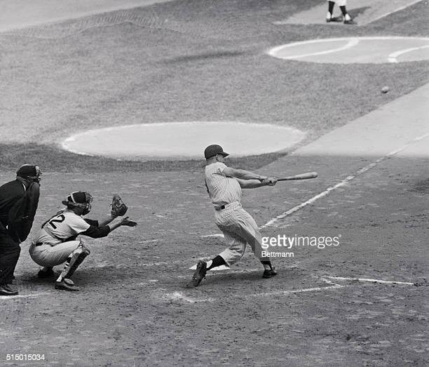 Ball streaks from bat as Yankees' Roger Maris lofts this 61st homer of the season into the right field seats, October 1st. The blew surpassed the all...