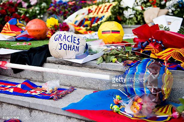 A ball with a message saying 'Thanks Johan' in Catalan left by football fans to pay tribute to late Dutch football star Johan Cruyff is seen amongst...