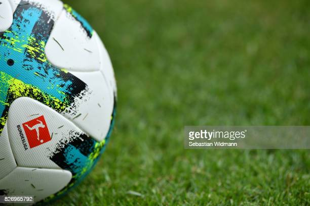 A ball with the Bundesliga logo lies on the pitch during the Second Bundesliga match between SSV Jahn Regensburg and 1 FC Nuernberg at Continental...