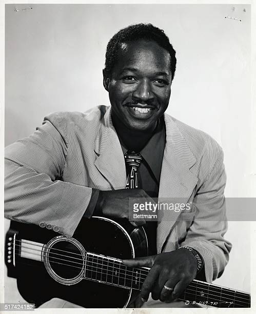 BalladeerJosh White appearing in Columbia's The Walking Hills with Randolph Scott and Ella Raines has sung his songs and played his guitar for the...