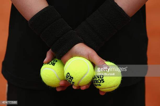 A ballboy holds Roland Garros 2015 tennis balls on day three of the 2015 French Open at Roland Garros on May 26 2015 in Paris France