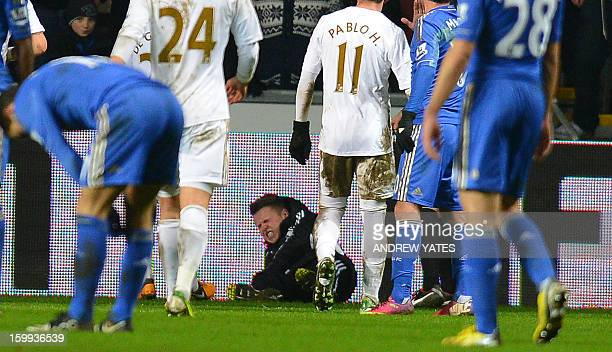 Ballboy lies on the grounf and reacts after a altercation with Chelsea's Belgium midfielder Eden Hazard during the English League Cup semi-final...