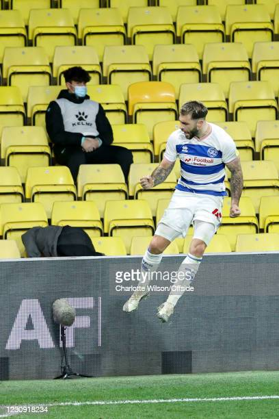 Ballboy looks unimpressed as Charlie Austin of QPR celebrates after scoring their 1st goal during the Sky Bet Championship match between Watford and...