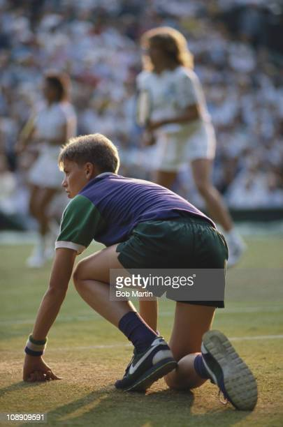 A ballboy prepares to retrieve any out balls during the Wimbledon Lawn Tennis Championships on 1st July 1988 at the All England Lawn Tennis and...