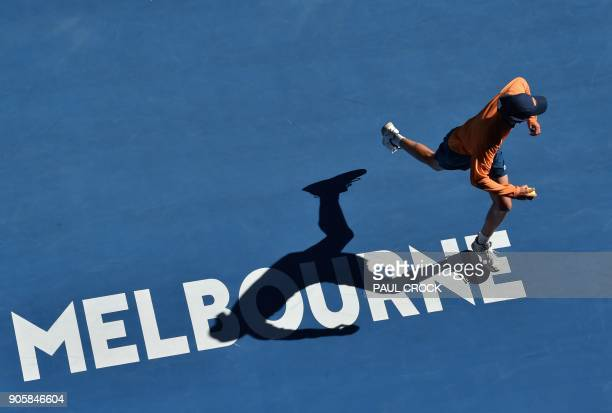 A ballboy runs on court during the men's singles second round match between Spain's Rafael Nadal and Argentina's Leonardo Mayer on day three of the...